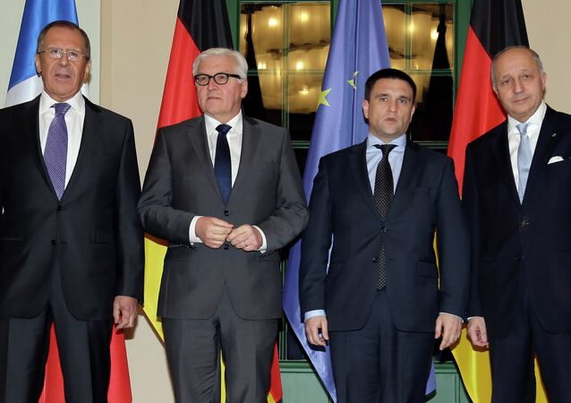 German Foreign Minister Frank-Walter Steinmeier, second left, welcomes his counterparts from France, Laurent Fabius, right, Russia, Sergey Lavrov, left, and Ukraine, Pavlo Klimkin, second right, for a meeting in Berlin