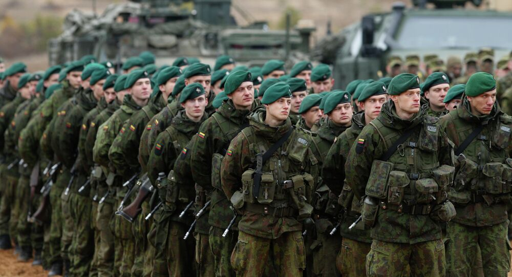 Lithuanian soldiers stand during a military exercise 'Iron Sword 2014' at the Gaiziunu Training Range in Pabrade some 60km.(38 miles) north of the capital Vilnius, Lithuania