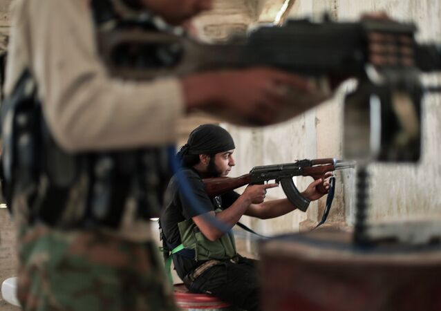 Rebel fighters from the Islamic Front, Syria's largest rebel coalition, hold a position on July 13, 2014 during clashes with militants of the Islamic State (IS), formerly known as the Islamic State in Iraq and the Levant (ISIL)