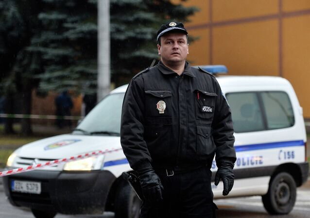 A police officer patrols near a restaurant where a gunman opened fire in Uhersky Brod, February 24, 2015