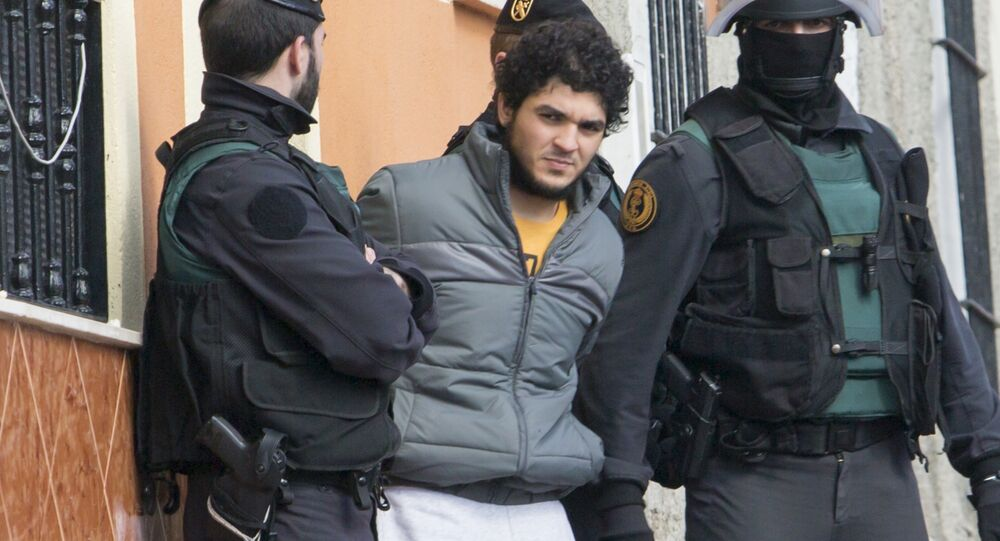 One of four people suspected of creating and operating several Internet platforms spreading propaganda, particularly for the Islamic State group in a bid to recruit young women to join Islamic State militans is arrested in Melilla.