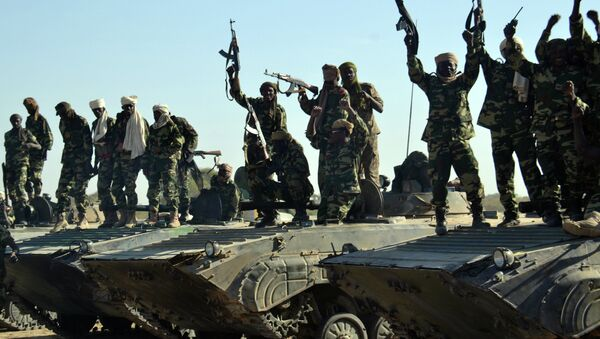 Chadian troops gather on February 1, 2015 near the Nigerian town of Gamboru, just accros the border from Cameroon - Sputnik International