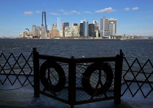 Lower Manhattan appears behind a pair life preservers on a Staten Island Ferry in New York Harbor.