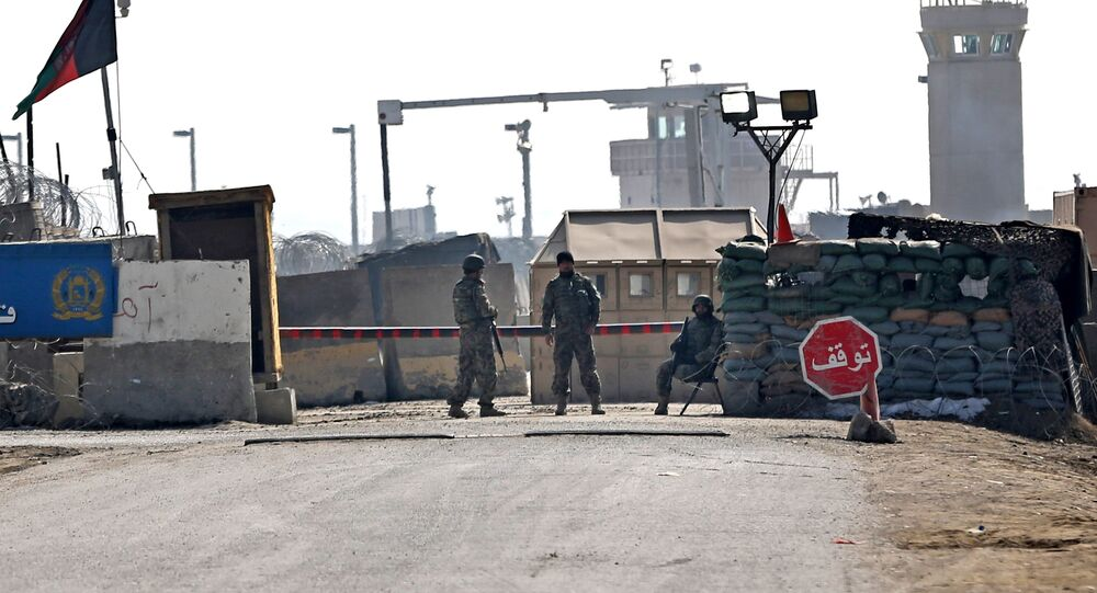 Afghan National Army (ANA) soldiers stand guard at the main gate of the Parwan Detention Facility Center on the outskirts of Bagram, some 50 kilometers (30 miles) north of Kabul, Afghanistan