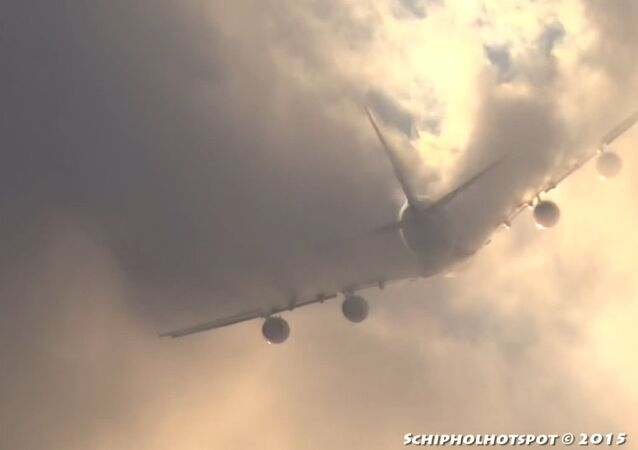 Airbus A380 Slashes Through Clouds