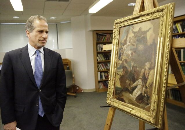 Richard Zabel, Deputy U.S. Attorney for the Southern District of New York looks at the 18th-century painting attributed to painter Giovanni Battista Tiepolo, The Holy Trinity appearing to Saint Clement, during a ceremony to return the painting and an Etruscan bronze statuette depicting the Greek hero Herakles, to the Italian government