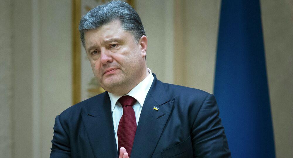 Ukrainian President Petro Poroshenko gestures as he speaks to the media after the peace talks in Minsk, Belarus
