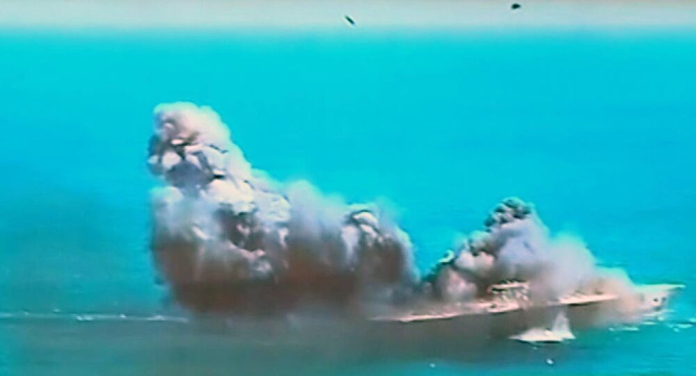 This image taken from Iranian state TV, shows damage to a mock U.S. aircraft carrier during large-scale naval and air defense drills by Iran's Revolutionary Guard, near the Strait of Hormuz, Iran