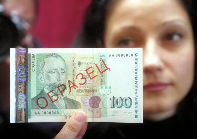 A model holds a BGN 100 banknote