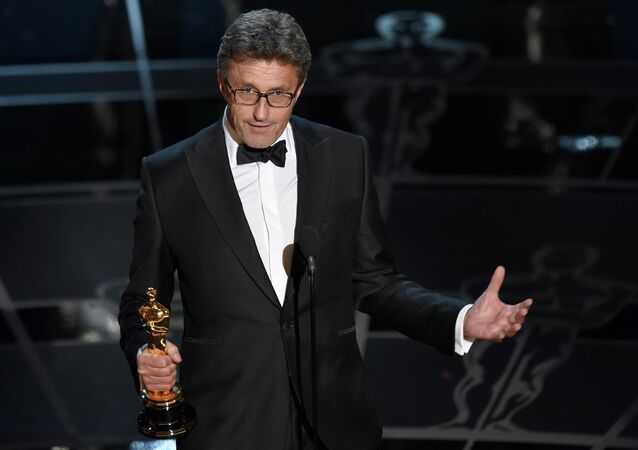 "Pawel Pawlikowski accepts the award for best foreign language film for ""Ida"" at the Oscars"