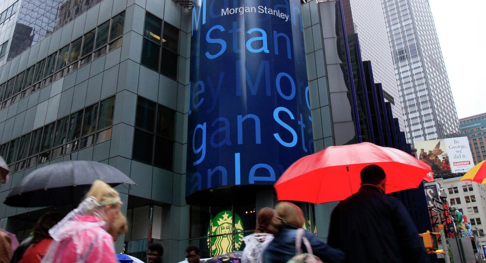 People walk by Morgan Stanley headquarters in New York's Times Square