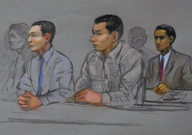 This courtroom sketch shows defendants Azamat Tazhayakov, left, Dias Kadyrbayev, center, and Robel Phillipos, right, college friends of Boston Marathon bombing suspect Dzhokhar Tsarnaev, during a hearing in federal court