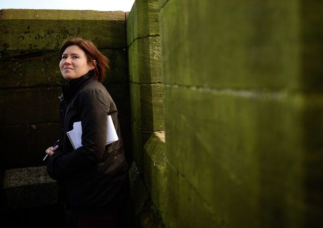 Reuters reporter Maria Golovnina stands atop a church steeple