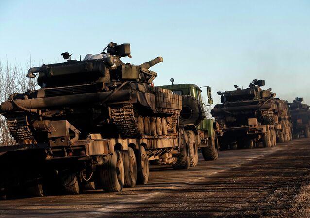 Military trucks from the Ukrainian armed forces transport tanks on the road near Artemivsk, eastern Ukraine, February 24, 2015