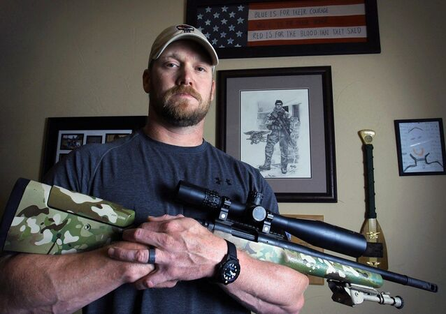 In this April 6, 2012, photo, former Navy SEAL and author of the book American Sniper poses in Midlothian, Texas. A Texas sheriff has told local newspapers that Chris Kyle has been fatally shot along with another man on a gun range, Saturday, Feb. 2, 2013