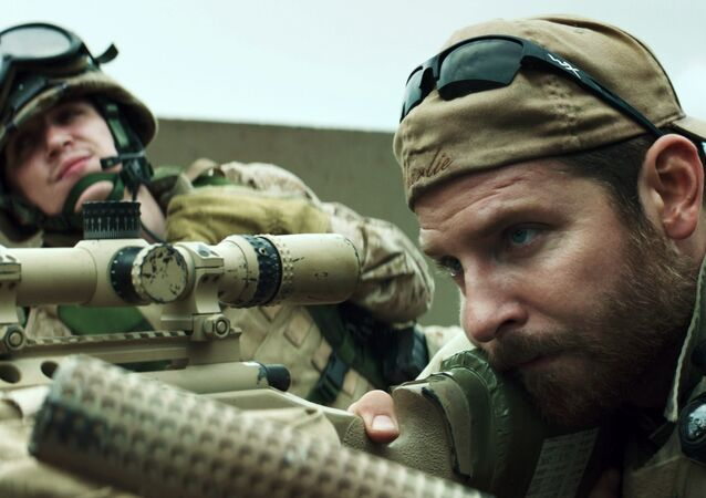In this image released by Warner Bros. Pictures, Kyle Gallner, left, and Bradley Cooper appear in a scene from American Sniper. The film is based on the autobiography by Chris Kyle