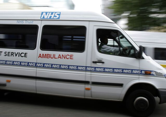 Ambulances belonging to the National Health Service, seen, outside one of London's major hospitals St Mary's, in Paddington, London
