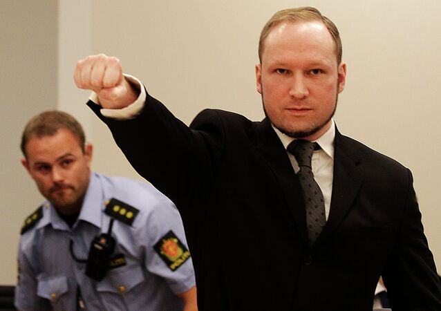 Anders Behring Breivik, makes a salute after arriving in the court room at a courthouse in Oslo, August 2012.
