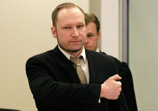 Accused Norwegian Anders Behring Breivik gestures as he arrives at the courtroom, in Oslo, Norway