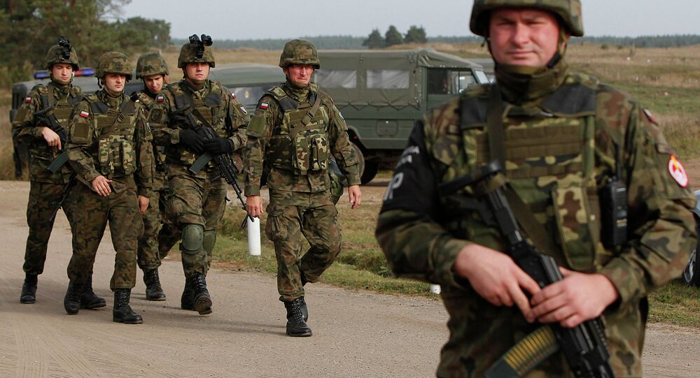 Troops from Poland march during an exercise in Bemowo Piskie near Orzysz, in northeastern Poland. File photo