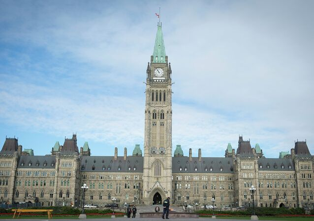 The Canadian Parliament is seen on October 23, 2014, in Ottawa, the day after multiple shootings in the capital city and Parliament buildings left a soldier dead and others wounded