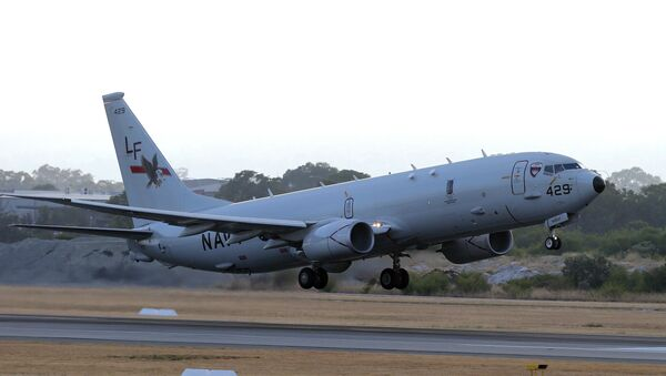 A U.S. Navy P-8 Poseidon takes off from Perth Airport in 2014. - Sputnik International