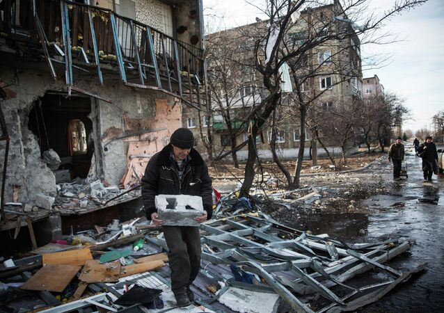 A man salvages cinder blocks from a destroyed building on February 25, 2015 in Debaltseve, Ukraine
