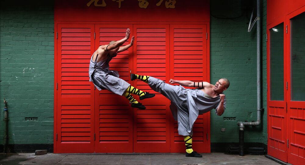 Shaolin monks pose for a photograph in Chinatown on February 23, 2015 in London, England