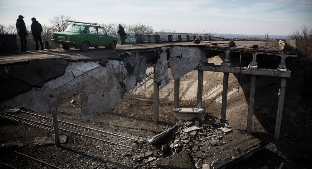 A car drives over a partially destroyed bridge on February 25, 2015 in Debaltseve, Ukraine