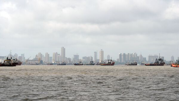 Ships are seen anchored in the Arabian sea following following the closure of the Mumbai port after a maritime accident involving the cargo ship MSC Chitra off the Mumbai coast on August 11, 2010 - Sputnik International