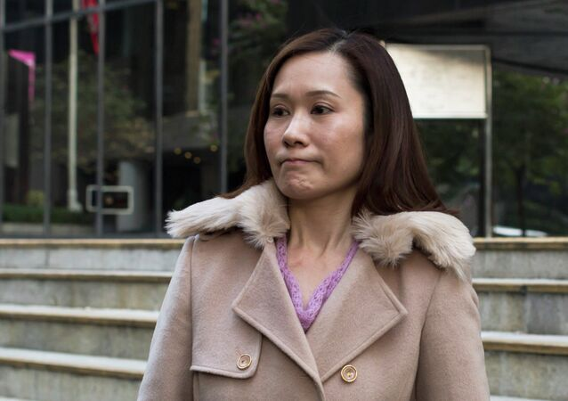 Law Wan-tung, former employer of Indonesian domestic helper Erwiana Sulistyaningsih, leaves the district court in Hong Kong
