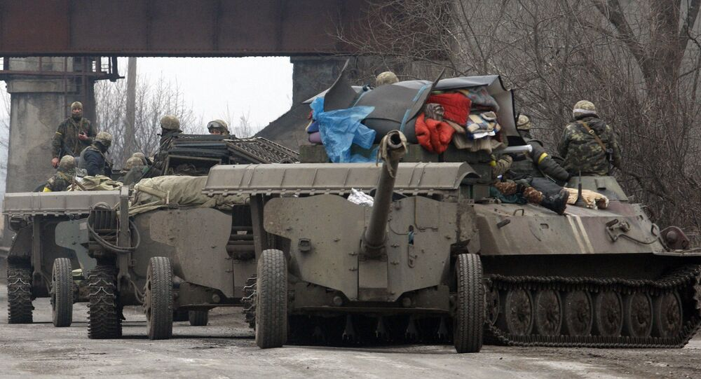 Ukrainian Armoured Personnel Carriers move cannons from their position near eastern Ukrainian city of Artemivsk, in the Donetsk region