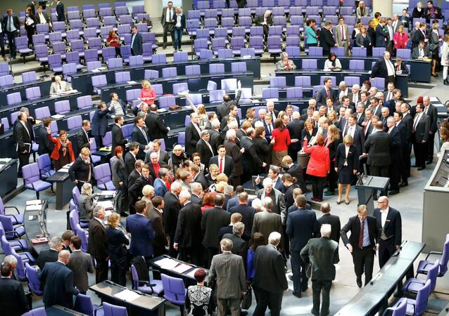 German deputies cast their vote on the approval to extend Greece's bailout, during a session of the Bundestag, the lower house of parliament, in Berlin February 27, 2015.