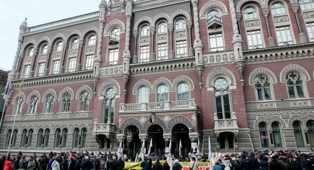 People demanding the resignation of the Ukraine's central bank chief Valeria Gontareva gather in front of the central bank office in Kiev