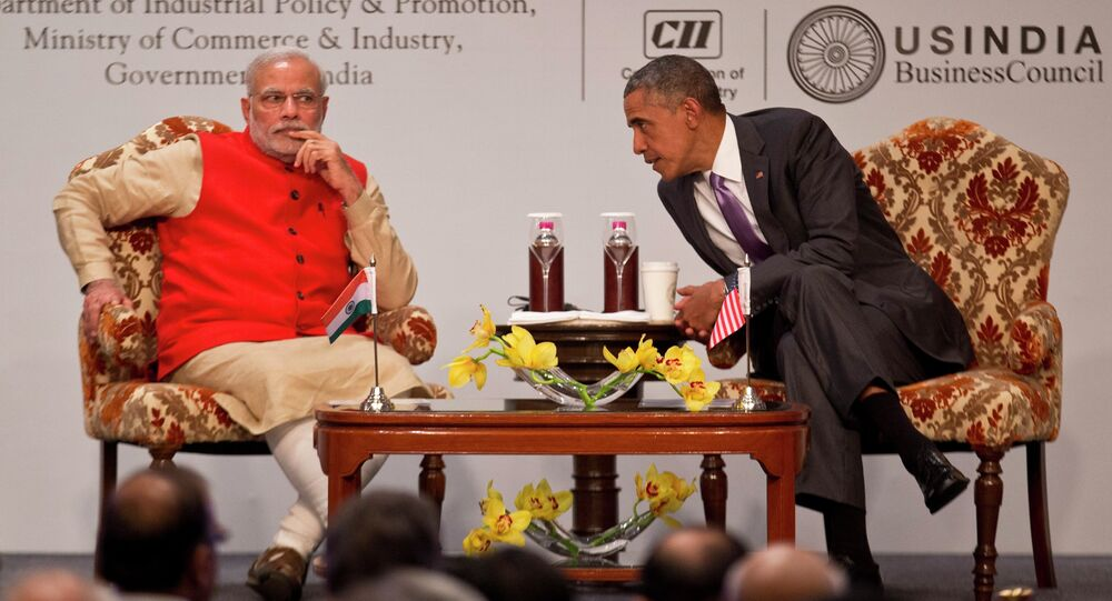 U.S. President Barack Obama, right leans towards Indian Prime Minister Narendra Modi to talk to him during the India-U.S business summit in New Delhi, India, Monday, Jan. 26, 2015.