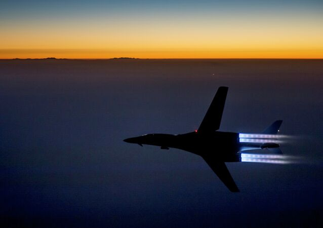 A fighter jet flies over northern Iraq after conducting airstrikes against Islamic State group targets in Syria.