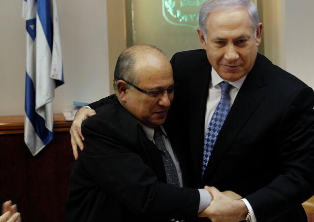 In this 2011 photo, Israel Prime Minister Benjamin Netanyahu hugs Meir Dagan, the then-director of Israel spy agency Mossad.