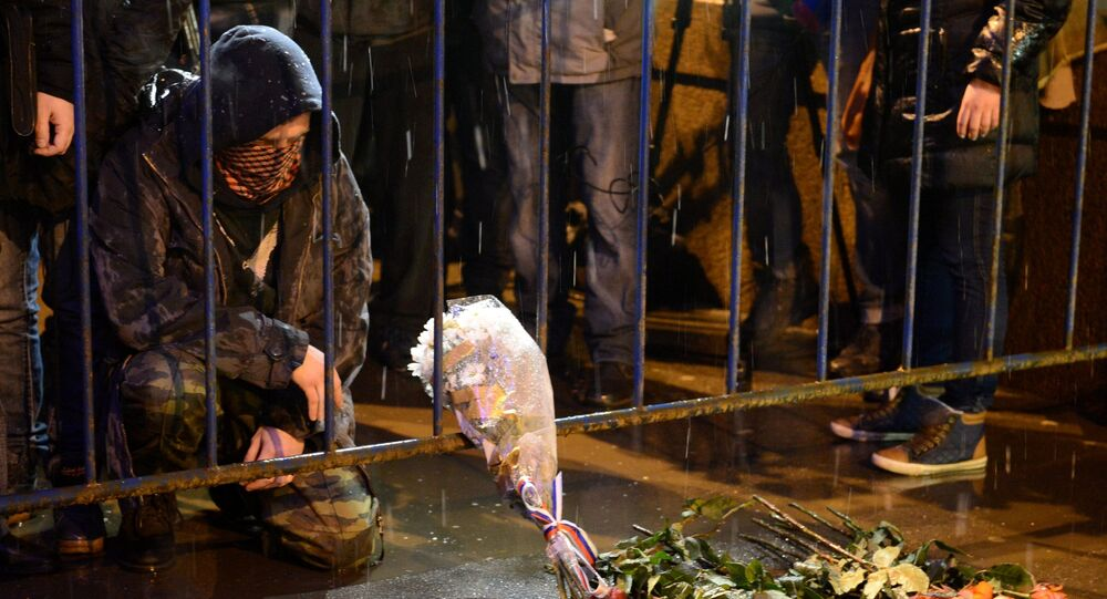 People bring flowers to the site of the murder of politician Boris Nemtsov, who was shot dead at the Moscow River bridge.