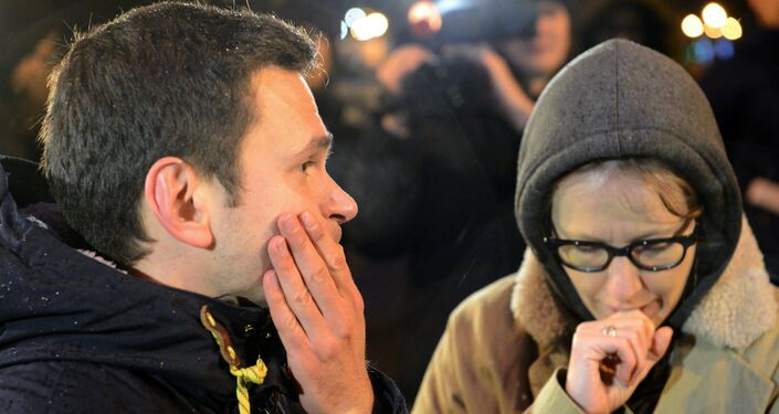 Oppositioner Ilya Yashin and TV host Ksenia Sobchak on the site of the killing of leading opposition figure and former deputy prime minister Boris Nemtsov