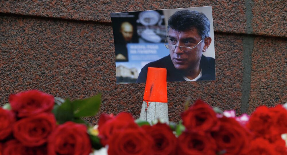 A photo and flowers are placed at the site where Boris Nemtsov was shot dead, near the Kremlin in central Moscow, February 28, 2015.