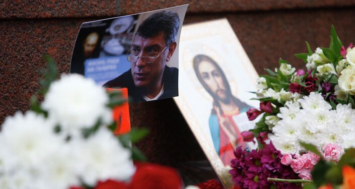A photo, an icon and flowers are placed at the site where Boris Nemtsov was shot dead, near the Kremlin in central Moscow, February 28, 2015.
