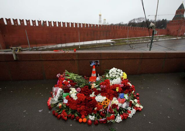A photo, candles and flowers are placed at the site where Boris Nemtsov was shot dead, near the Kremlin in central Moscow, February 28, 2015.