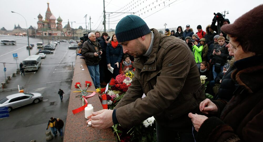 People visit the site where Boris Nemtsov was shot dead in central Moscow, February 28, 2015