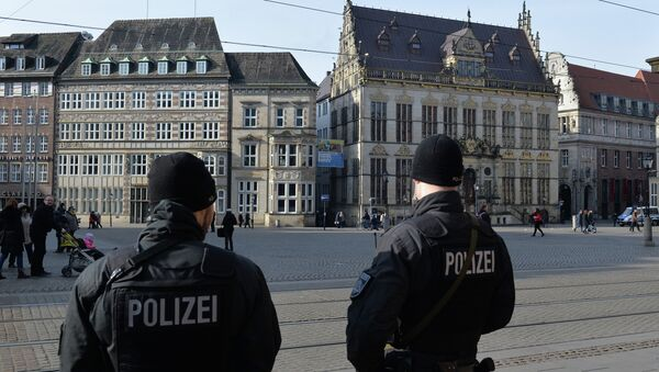 Policemen patrol on the market place in front of the city hall of Bremen, northwestern Germany, on February 28, 2015. Bremen police have specifically warned about Islamic terrorists at large in the Hanseatic city. - Sputnik International