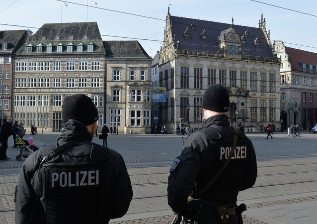 Policemen patrol on the market place in front of the city hall of Bremen, northwestern Germany, on February 28, 2015. Bremen police have specifically warned about Islamic terrorists at large in the Hanseatic city.