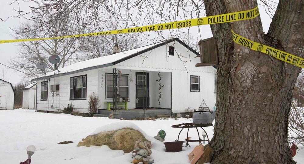 Police tape surrounds one of the crime scenes where gunman, Joseph Jesse Aldridge, killed seven people on Thursday night in Tyrone, Missouri