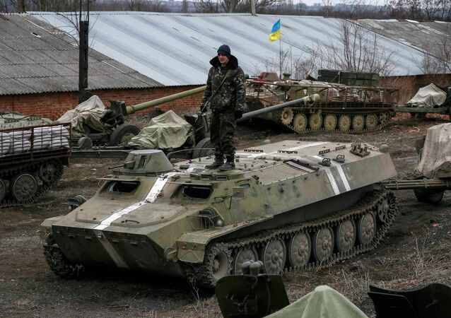 Armoured personnel carriers, military vehicles and cannons are seen at their new position as they pull back from the Horlivka region, near Druzhkivka, eastern Ukraine