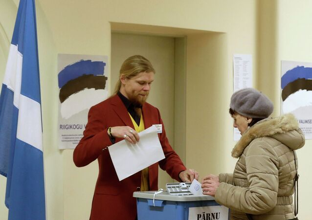 A woman casts her vote during a parliamentary election in Parnu