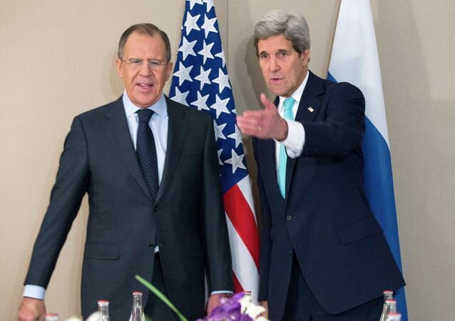 U.S. Secretary of State John Kerry (R) stands next to Russian Foreign Minister Sergei Lavrov during their meeting in Geneva March 2, 2015.