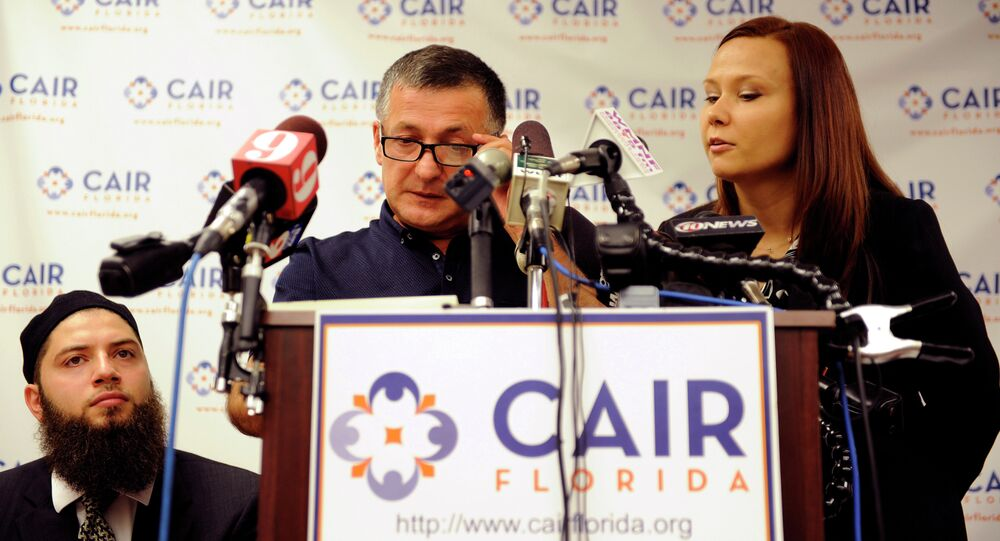 Abdulbaki Todashev (C) the father of Ibragim Todashev, speaks to the media, through interpreter Viktoryia Johnson, right, as he describes his quest for information into the shooting death of his son during a press conference at an office for the Council on American-Islamic Relations Florida.